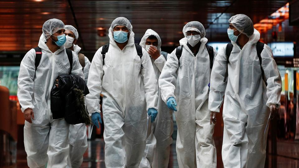 Seafarers who have spent the past months working onboard vessels arrive at the Changi Airport to board their flight back home to India during a crew change amid the coronavirus disease (COVID-19) outbreak in Singapore June 12, 2020.