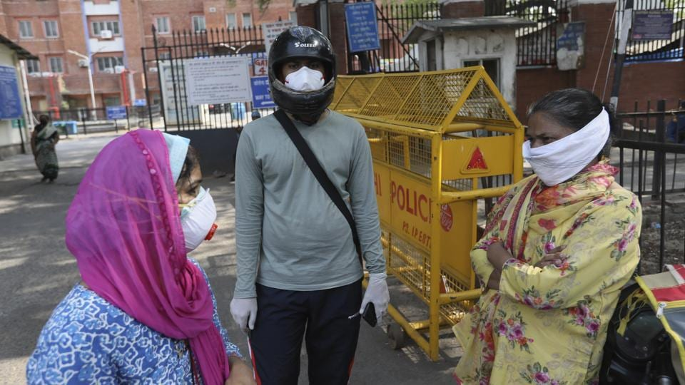 Relatives of Covid-19 patients stand outside a coronavirus designated hospital in New Delhi on Wednesday.