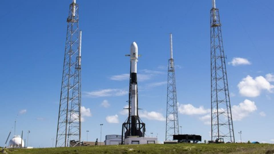 The Falcon 9 rocket at a launch pad in  Cape Canaveral, Florida, ahead of the June 13 Starlink mission that will launch 58 internet satellites into  orbit.