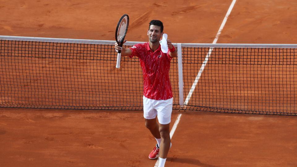 Serbia's Novak Djokovic celebrates after winning his match against Serbia's Viktor Troicki.