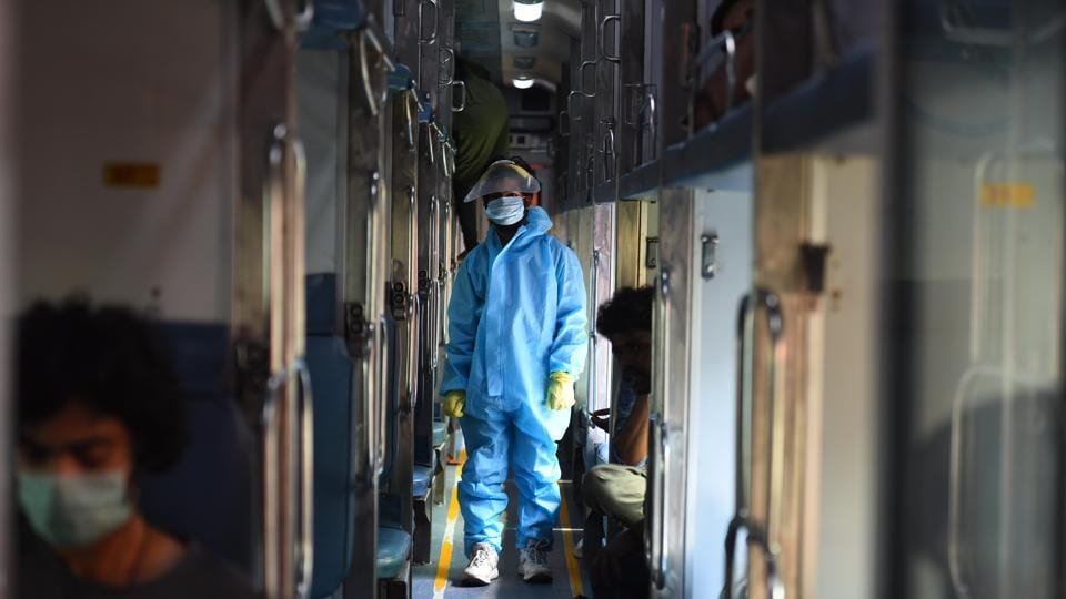 A passenger wearing PPE kit seen inside a Rajdhani Express train bound to Chennai from New Delhi amid Covid-19 lockdown