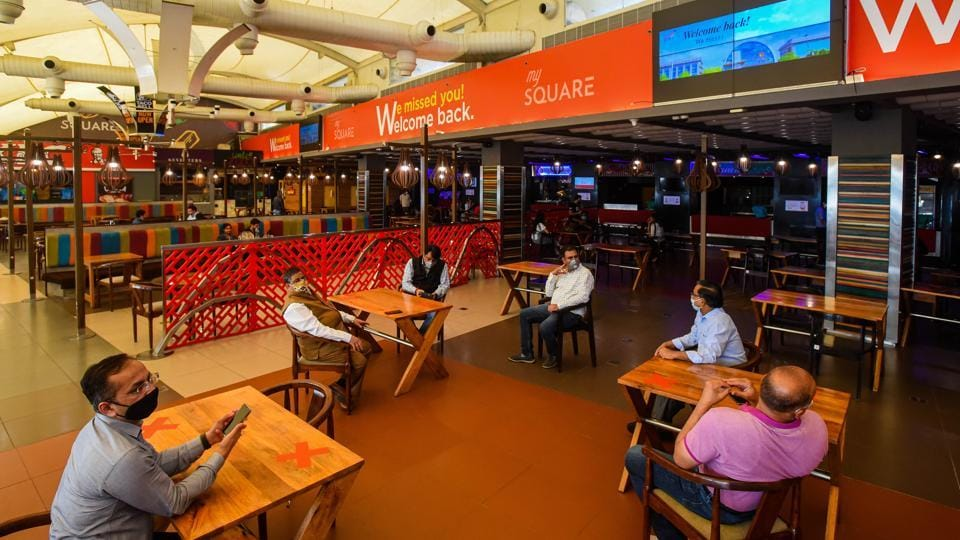 """People at the food court of a mall in New Delhi.  In the post-Covid-19 world, shopping malls will  become """"warehouses of e-commerce"""", according to a white paper of the West Bengal goverment."""