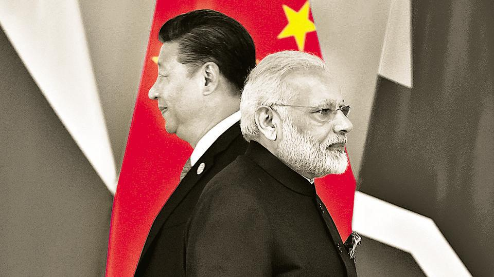 File photo:Chinese President Xi Jinping (L) and Indian Prime Minister Narendra Modi during  BRICS Summit.