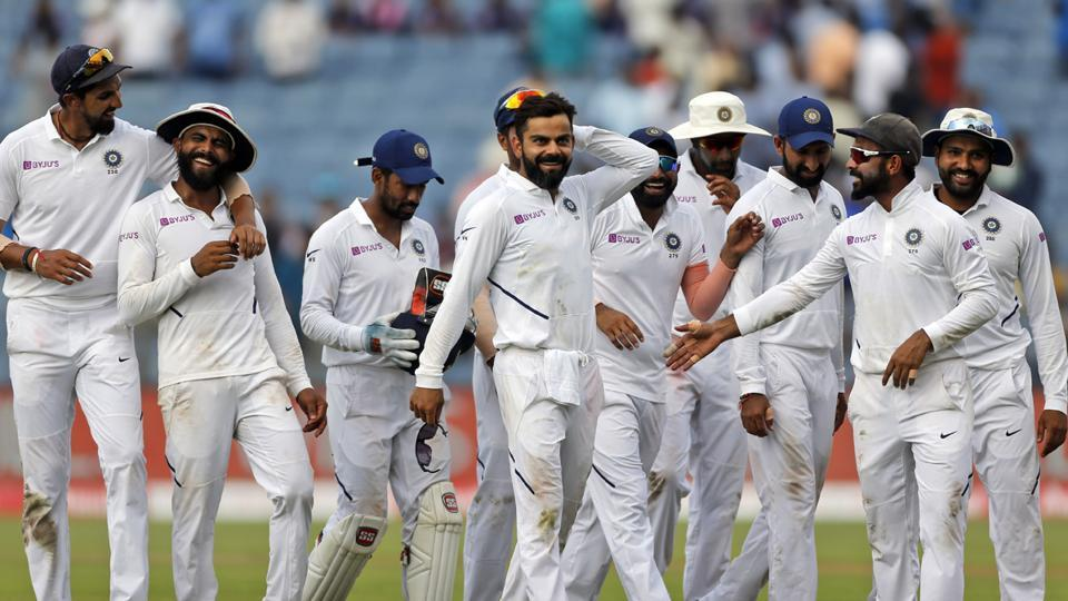 India's cricket team captain Virat Kohli, center, celebrates with teammates after winning the second cricket test match against South Africa in Pune, India, Sunday, Oct. 13, 2019. (AP Photo/Rajanish Kakade)