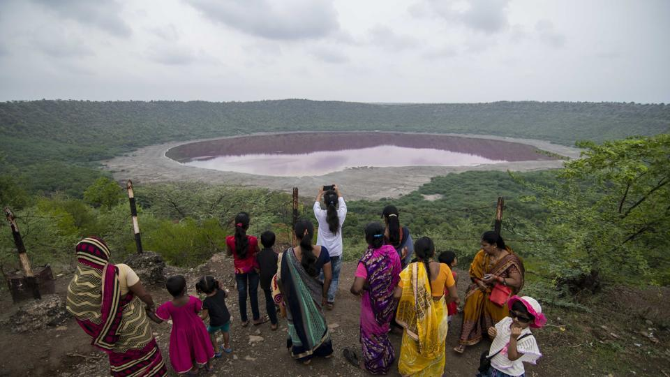 Locals in Buldhana gather around the Lonar lake after its water turned pink earlier this month.