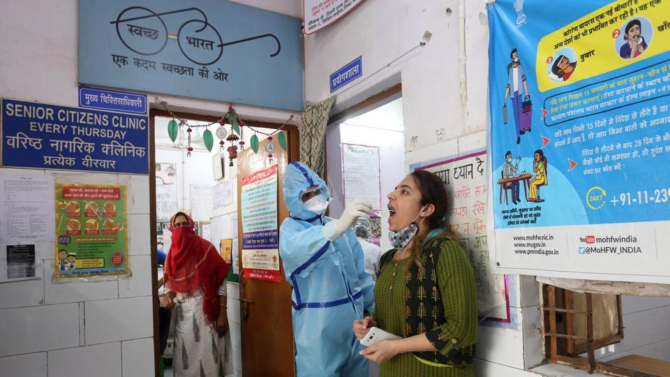 Testing team collecting swab samples of health workers and Delhi Government martials, at a Delhi Government Dispensary at Majnu Ka Tila, in New Delhi on Monday. (ANI Photo)