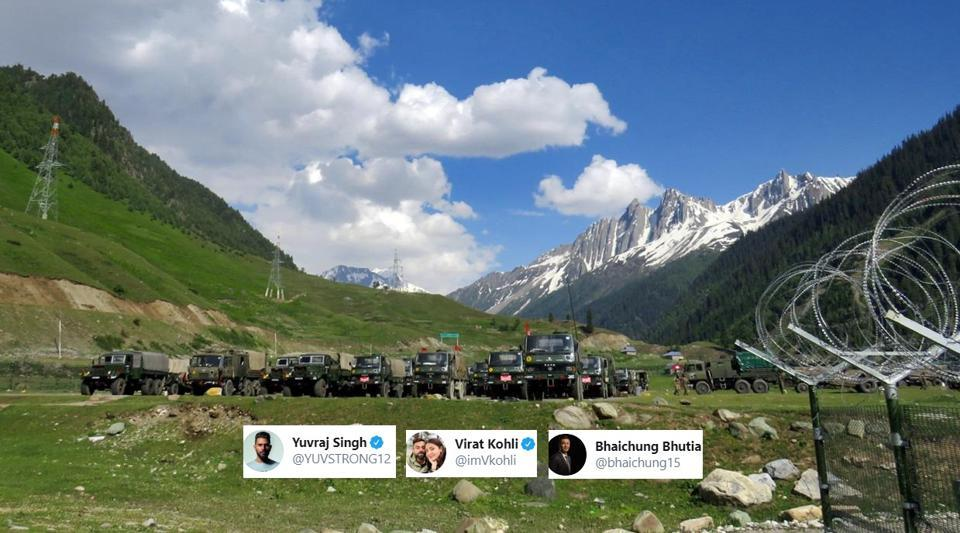 Indian army soldiers walk past their parked trucks at a makeshift transit camp before heading to Ladakh, near Baltal, southeast of Srinagar.