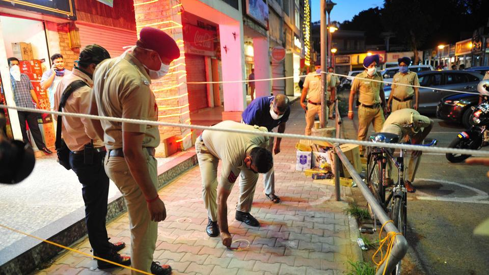 Two men had rained bullets at a liquor shop in Sector 9 on the evening of June 2, leaving four men injured.