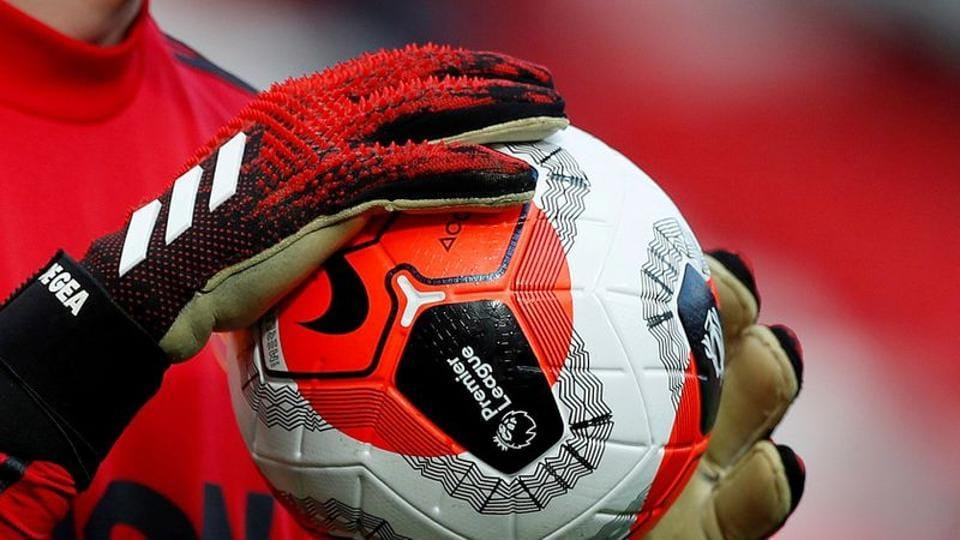 General view of a match ball held by Manchester United's David de Gea during the warm up before the match.