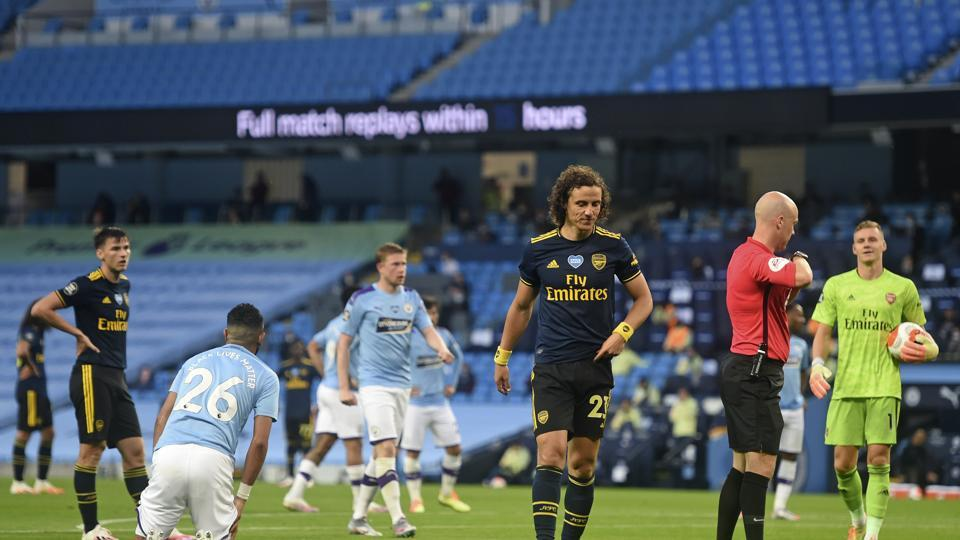 Arsenal's David Luiz leaves the field after getting a red card.