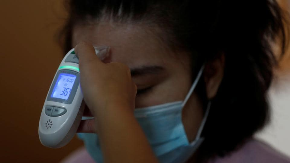 Maria Bravo gets her temperature measured before attending the daily workshops at the Alas Foundation centre for women with intellectual disabilities amid the COVID-19 outbreak in Madrid, Spain, June 16, 2020.