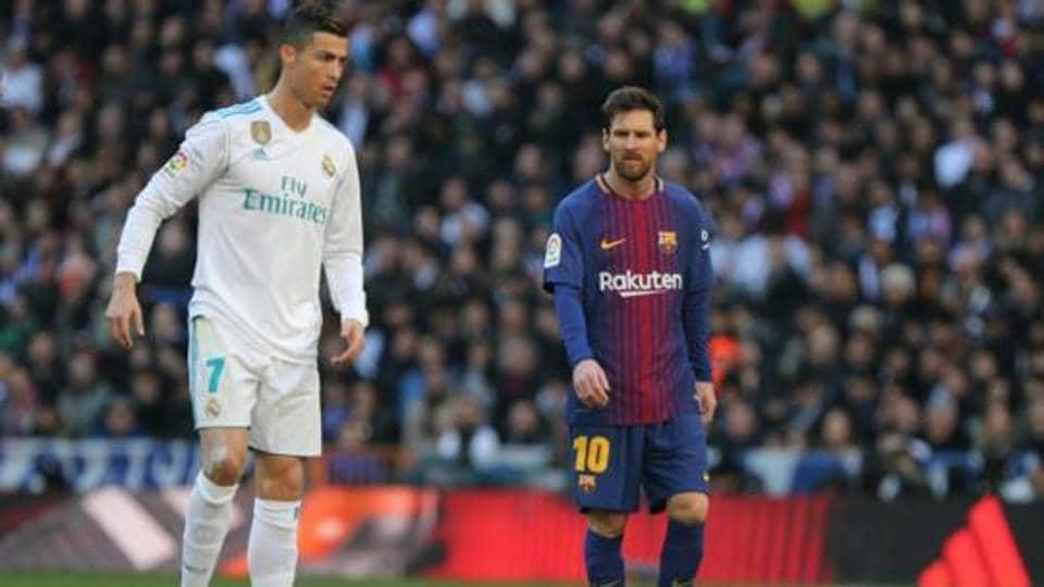 Cristiano Ronaldo in action with Barcelona's Lionel Messi.