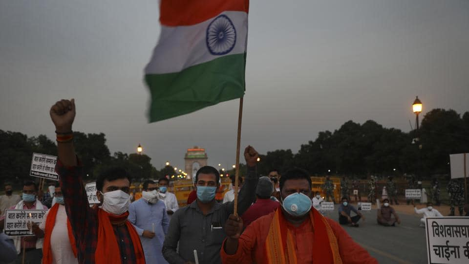Members of ruling Bharatiya Janata Party march in front of India Gate monument in New Delhi, India, holding candles as tributes to Indian soldiers killed during confrontation with Chinese soldiers in the Ladakh region.