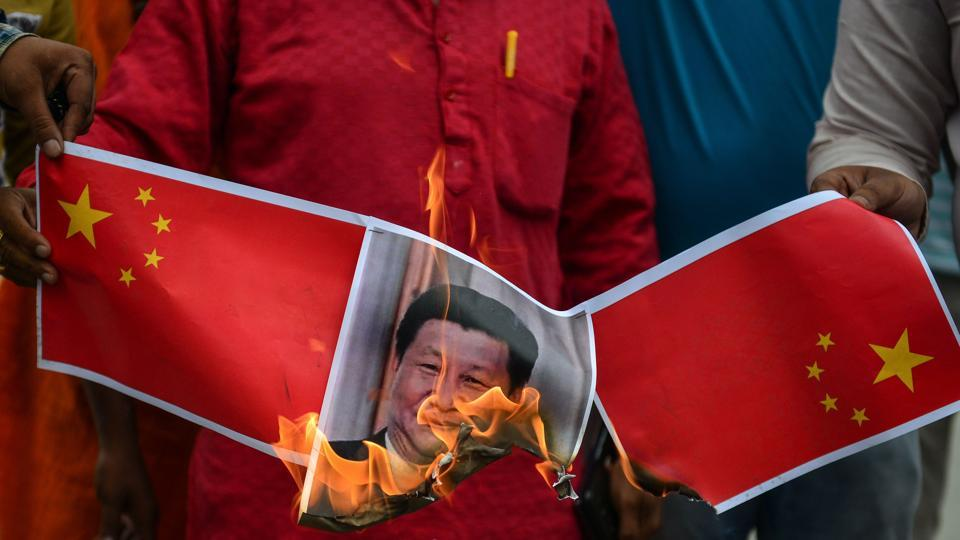 Bharatiya Janata Party (BJP) supporters burn posters and effigy of Chinese President Xi Jinping during an anti-China protest in Allahabad.