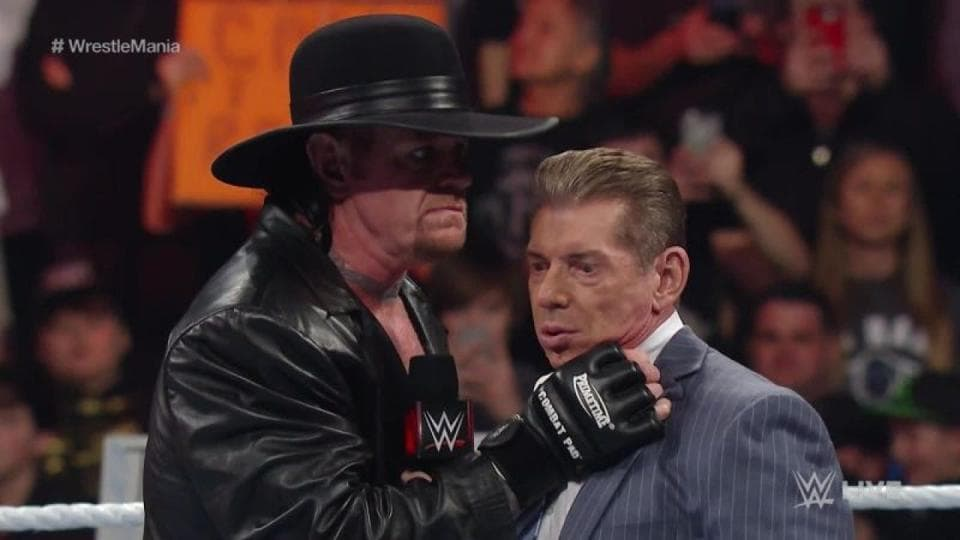 Vince McMahon with The Undertaker.