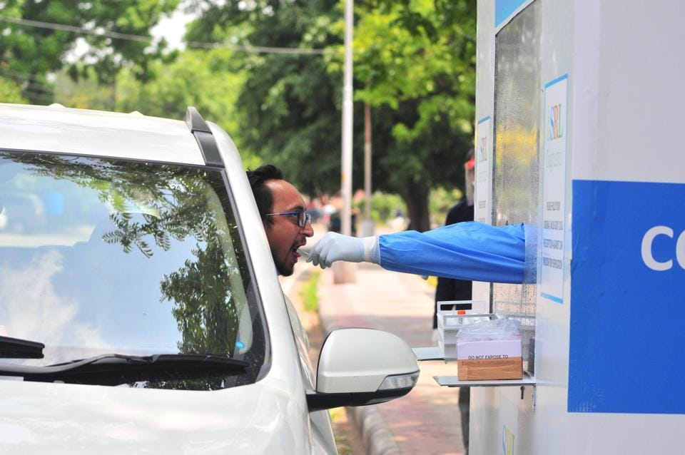 A man being testing for Covid 19 in a drive-through booth installed by a private laboratory at Sector 11, Chandigarh.