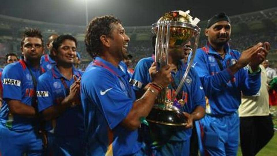 Sachin Tendulkar of India celebrates with the World Cup after beating Sri Lanka during the 2011 ICC World Cup Final