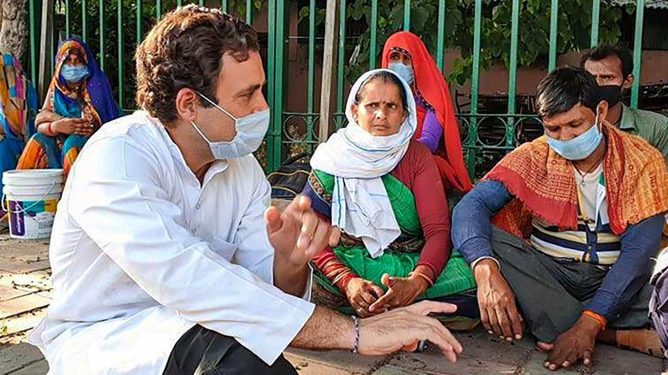 Former Congress president Rahul Gandhi interacts with migrant labourers who were walking on the Sukhdev Vihar flyover to reach their native places, amid ongoing COVID-19 lockdown, in New Delhi.