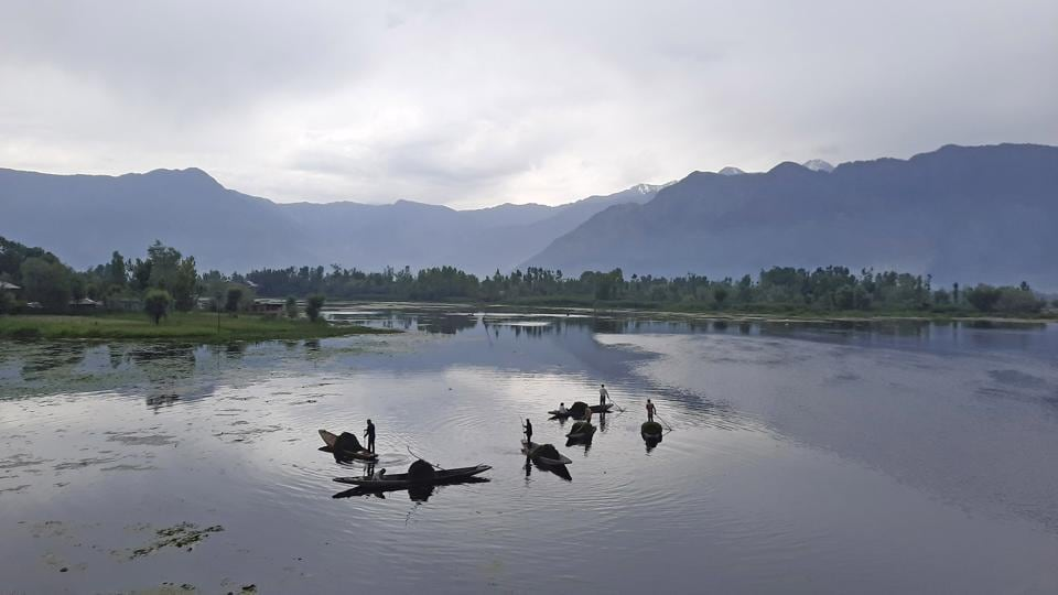 Kashmiri labourers are cleaning the Nigeen Lake in Srinagar.