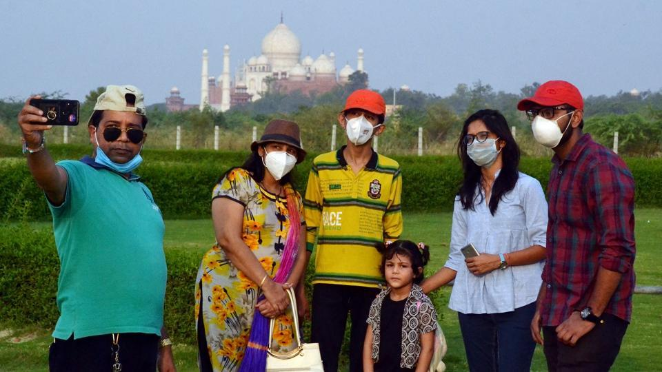 Tourists click a selfie in front of Taj Mahal, in Agra on this file photo.