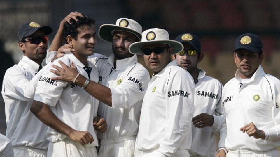 Ahmedabad, INDIA: Indian players Mohammed Kaif (L), Sachin Tendulkar (R), Gautam Gambhir (2R), Virender Sehwag (3R) and Harbhajan Singh (3L) congratulate teammate Irfan Pathan