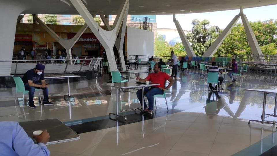 Employees follow social distancing norms at a cafeteria of Infosys company, Hinjewadi phase 3.