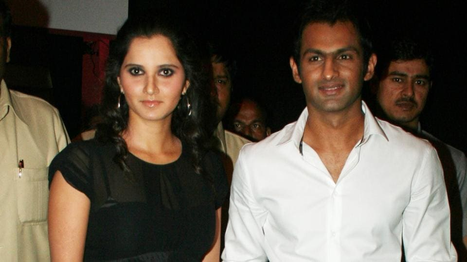 Indian tennis ace Sania Mirza and her Pakistani cricketer husband Shoaib Malik arrive for the launch of Italian fashion brand Diesel on April 29, 2010 in Mumbai, India.