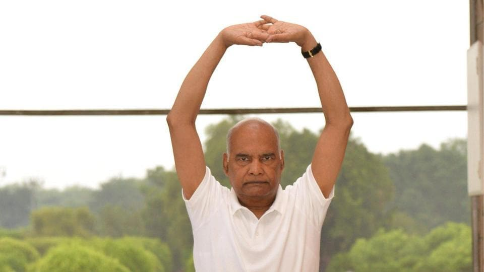 President Ram Nath Kovind performing yoga asanas.