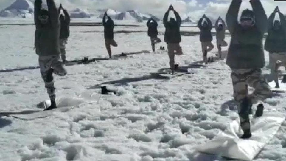 ITBP (Indo-Tibetan Border Police) personnel perform yoga at an altitude of 18000 feet in sub-zero temperatures.