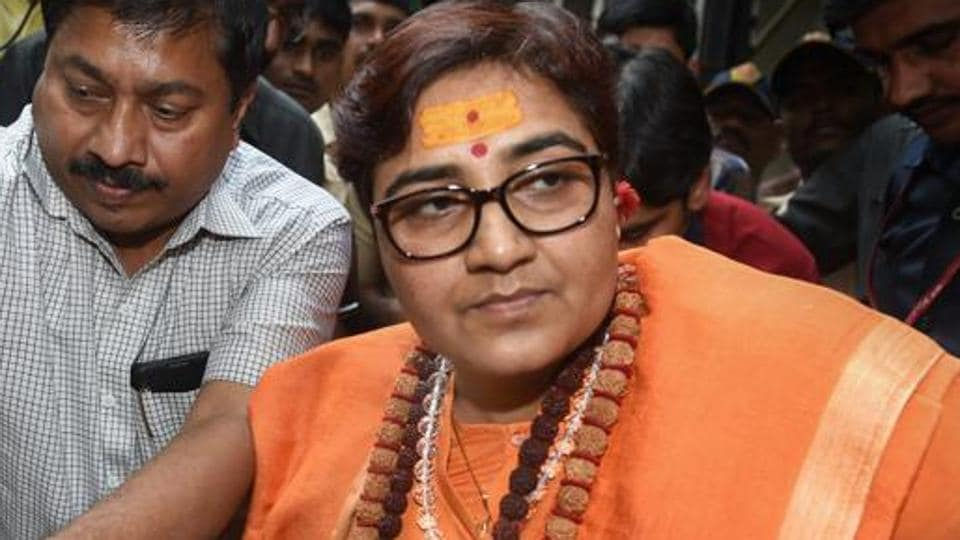 The 2008 Malegaon blast case accused Pragya Singh Thakur leaves the special NIA court after she was charged for terror conspiracy, murder, and other related offenses, in Mumbai.