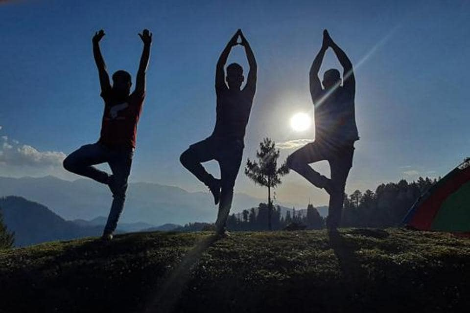 Jammu: Fitness enthusiasts perform yoga on the eve of International Day of Yoga, at Bhaderwah in Jammu, Saturday, June 20, 2020.