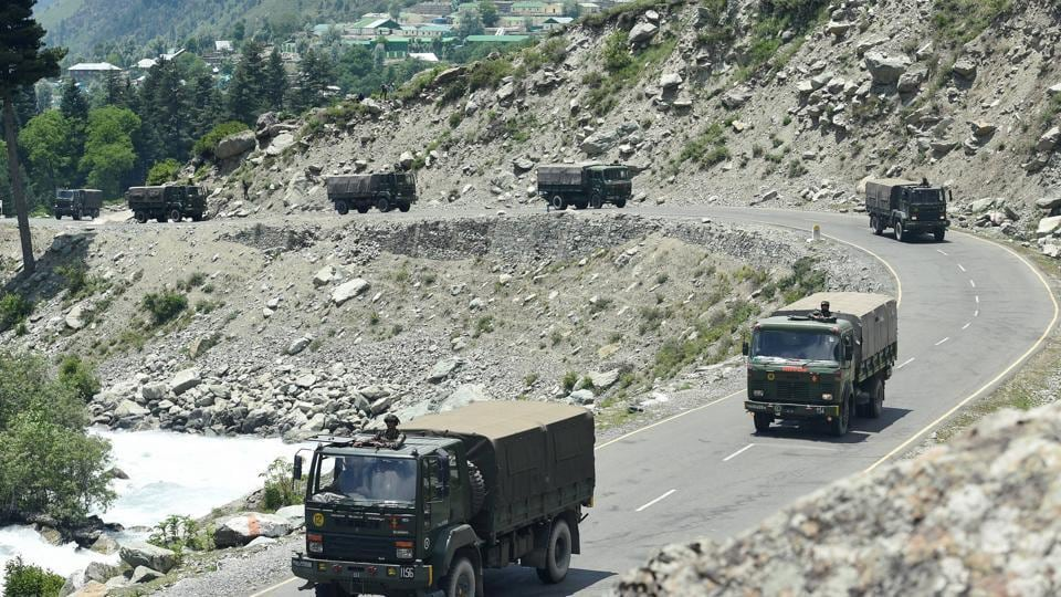 An army convoy moves along the Srinagar-Leh National highway, in Ganderbal district of Central Kashmir, Wednesday.