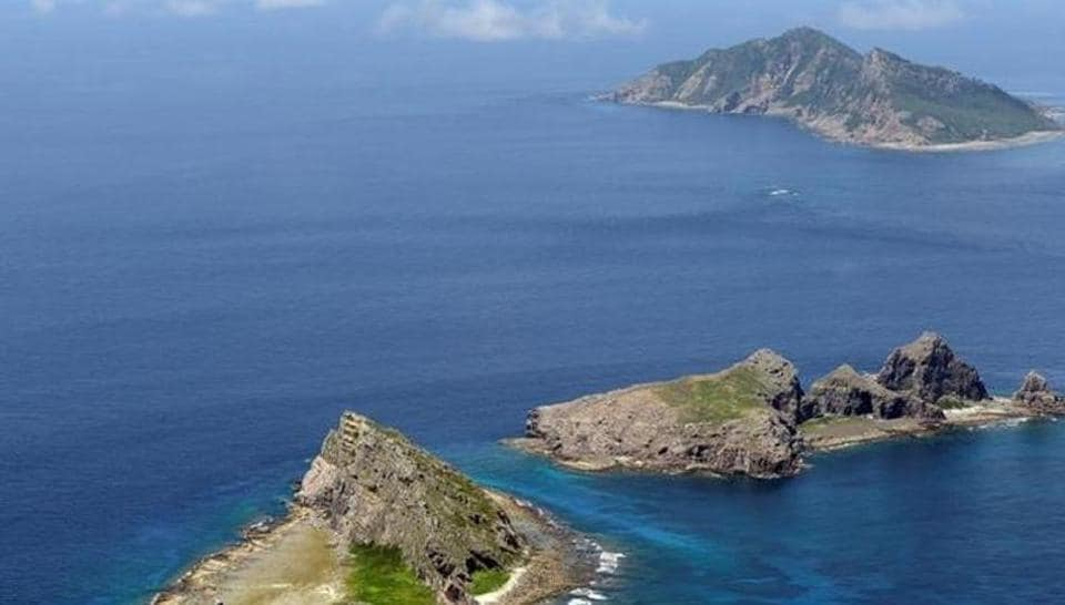 A group of disputed islands, Uotsuri island (top), Minamikojima (bottom) and Kitakojima, known as Senkaku in Japan and Diaoyu in China is seen in the East China Sea, in this photo taken by Kyodo