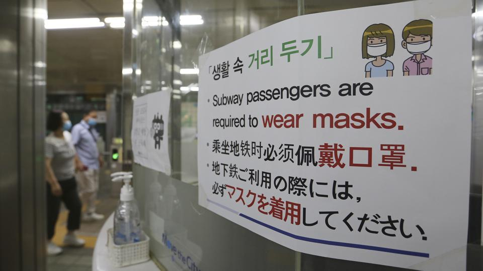 A notice on precautions against the new coronavirus is displayed at a subway station in South Korea, Monday, June 22, 2020. The sign at top reads: