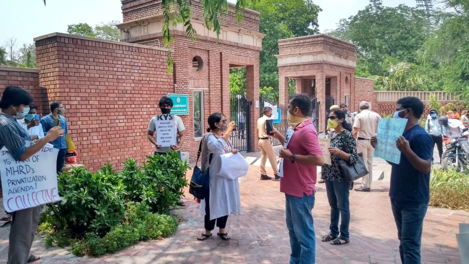 DUstudents protesting outside campus against open book exam