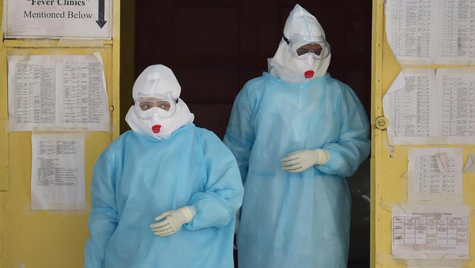 Medics wearing Personal Protective Equipment (PPE) suits coming out of the Covid-19 ward of Victoria Hospital, during the ongoing nationwide lockdown, in Bengaluru, Wednesday, June 17, 2020.
