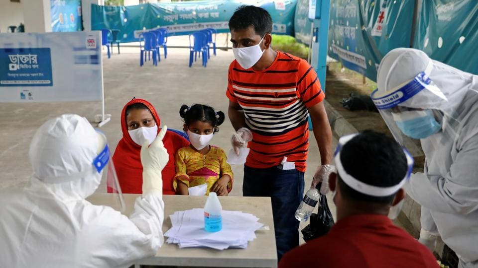 People consult a doctor before swab testing at Mugda Medical College and Hospital, as the coronavirus disease (COVID-19) outbreak continues, in Dhaka, Bangladesh, June 23, 2020.