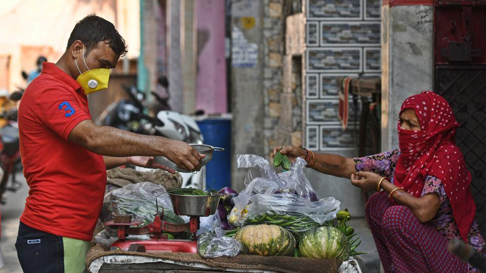Vajir Singh, who was an English teacher prior to lockdown sells vegetables at Sultanpuri in New Delhi, India, on Monday, June 22, 2020.