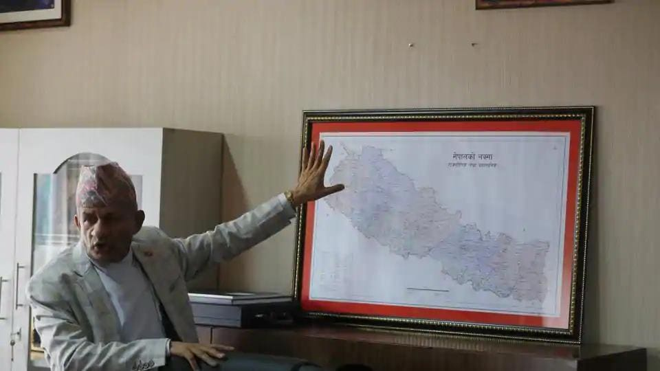 Nepal's foreign minister Pradeep Gyawali points to a map of Nepal in Kathmandu.
