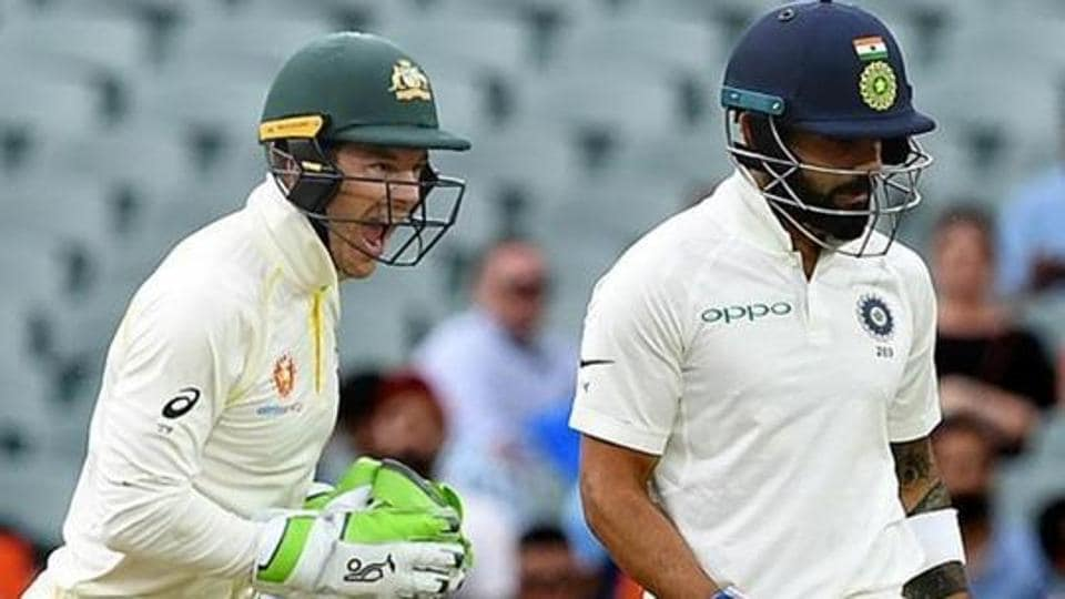 Australia's captain Tim Paine (L) celebrates as India's captain Virat Kohli leaves the field after being dismissed on day three of the first test match between Australia and India at the Adelaide Oval in Adelaide, Australia, December 8, 2018.