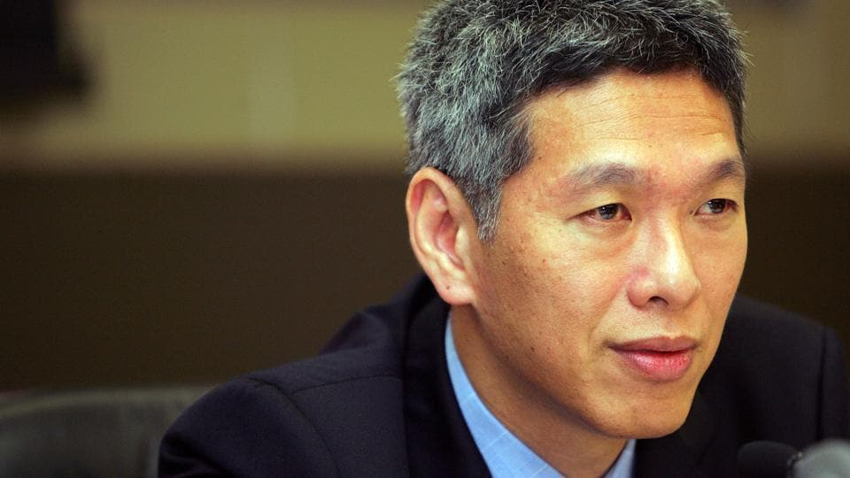 Lee Hsien Yang answers questions during a news conference in Singapore.