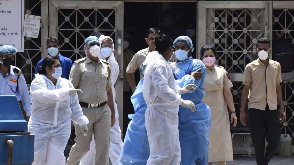 File photo: CATS ambulance staff in PPE suits and doctors of LNJP Hospital in New Delhi.