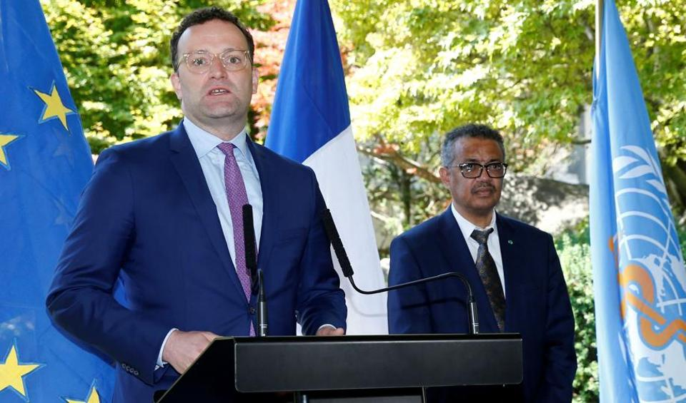 Germany's Federal Minister of Health Jens Spahn, flanked by Tedros Adhanom Ghebreyesus, Director-general of the World Health Organization (WHO), speaks during a news conference in Geneva, Switzerland.