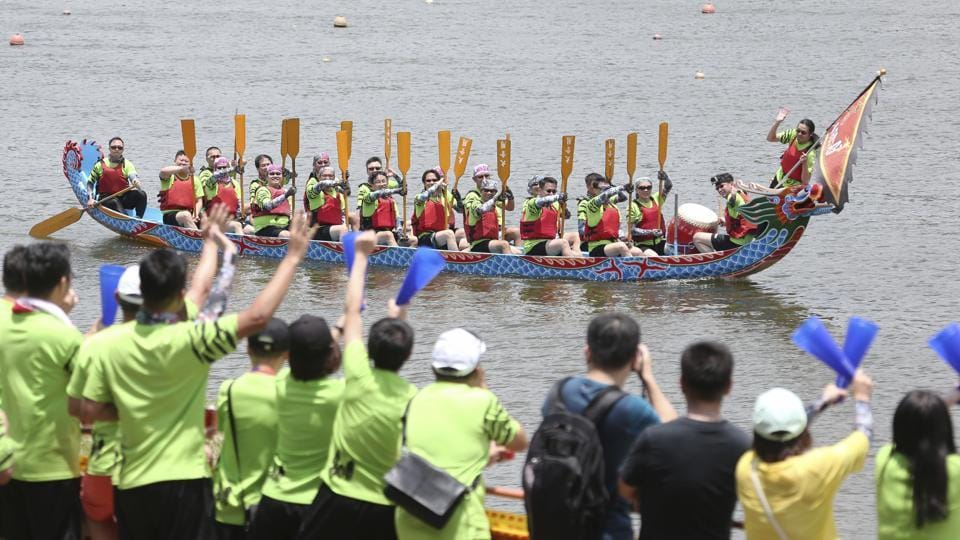 Dragon boat crew members cheer during the traditional Chinese dragon boat race in Taipei, Taiwan, Thursday, June 25, 2020. Dragon boat races are in remembrance of Chu Yuan, an ancient Chinese scholar-statesman, who drowned in 277 B.C. while denouncing government corruption.  (AP)