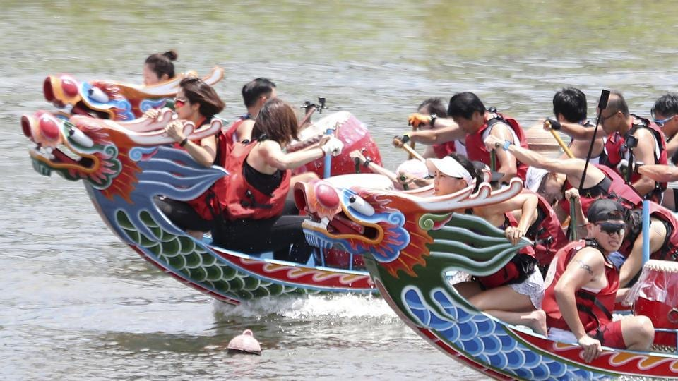 Crew members participate in a traditional Chinese dragon boat race in Taipei, Taiwan, Thursday, June 25, 2020. Dragon boat races are in remembrance of Chu Yuan, an ancient Chinese scholar-statesman, who drowned in 277 B.C. while denouncing government corruption.