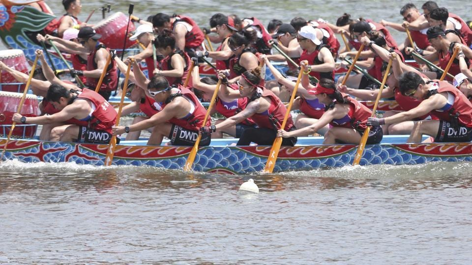 Boat crew members participate in a traditional Chinese dragon boat race in Taipei, Taiwan, Thursday, June 25, 2020.  (AP)