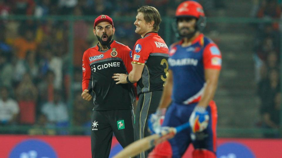 Royal Challengers Bangalore captain Virat Kohli and Shane Watson celebrates the wicket of Karun Nair of the Delhi Daredevils during match 56 of 2017 Indian Premier League.