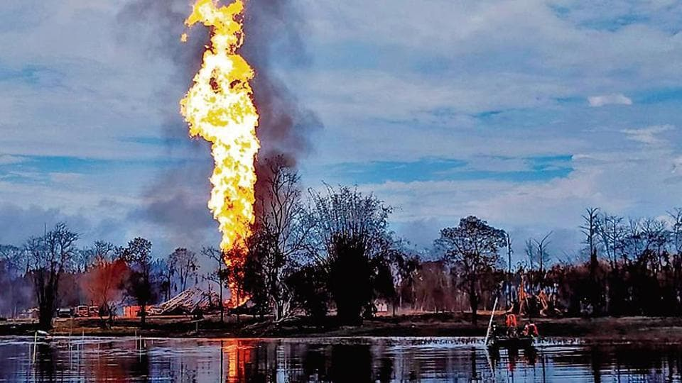 Army personnel help douse the fire after a blowout in a gas well of Oil India Limited at Baghjan, Tinsukia district on Tuesday.