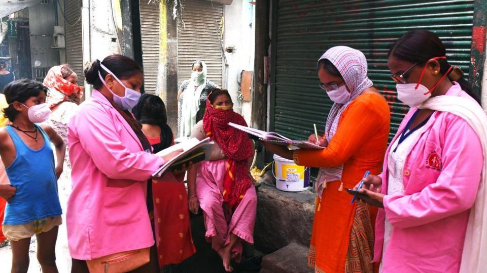 Volunteers conducting door to door survey to detect Covid-19 symptomatic cases at Nabi Karim in New Delhi.