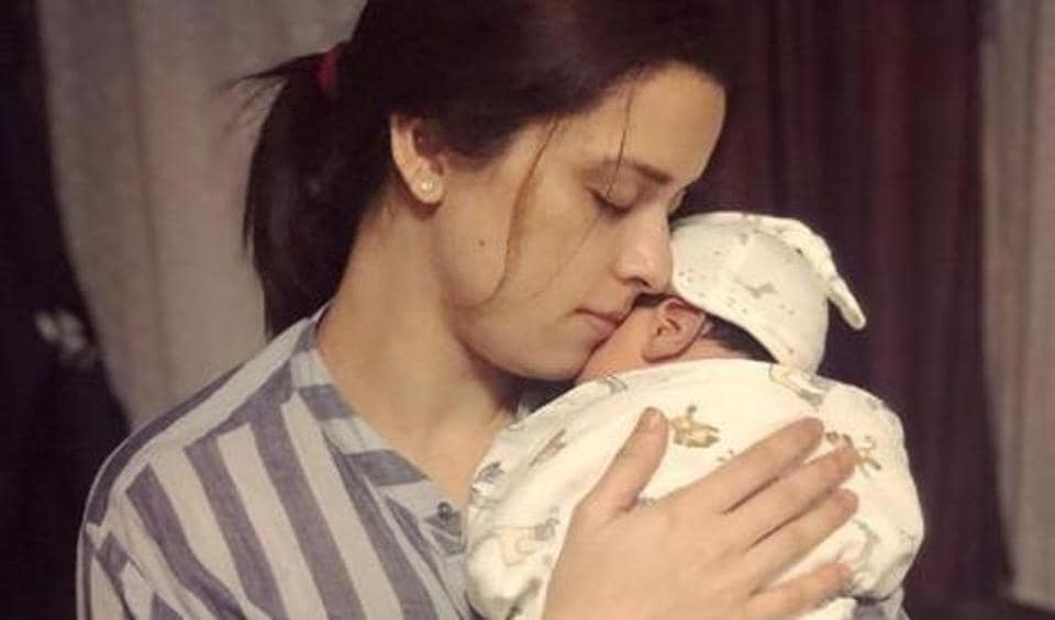 Ekta Kaul holds her son Ved lovingly in her arms.